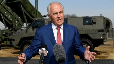Prime Minister Malcolm Turnbull with a Bushmaster, one of Australia's export success stories.