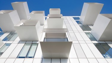 Upper House apartments by JCB Architects offers a split communal area.