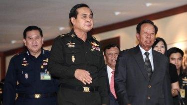 Heneral Prayuth Chan-ocha (centre) ordered raids on 44 Bangkok IVF clinics.