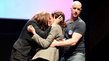 Security confronts protesters who kissed on stage after gatecrashing a Coalition for Marriage launch in Melbourne.