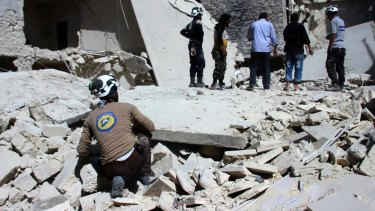 The aftermath of     airstrikes in the Bustan al-Qasr neighbourhood of Aleppo.