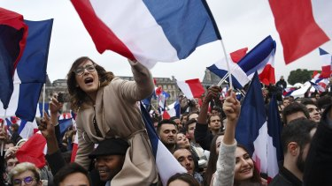 Supporters celebrate after Emmanuel Macron is victorious.