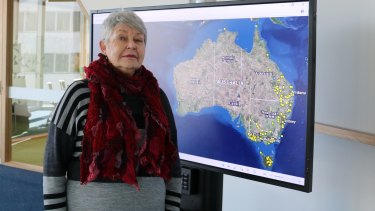 Historian Professor Lyndall Ryan in front of the map mapping Aboriginal massacres.