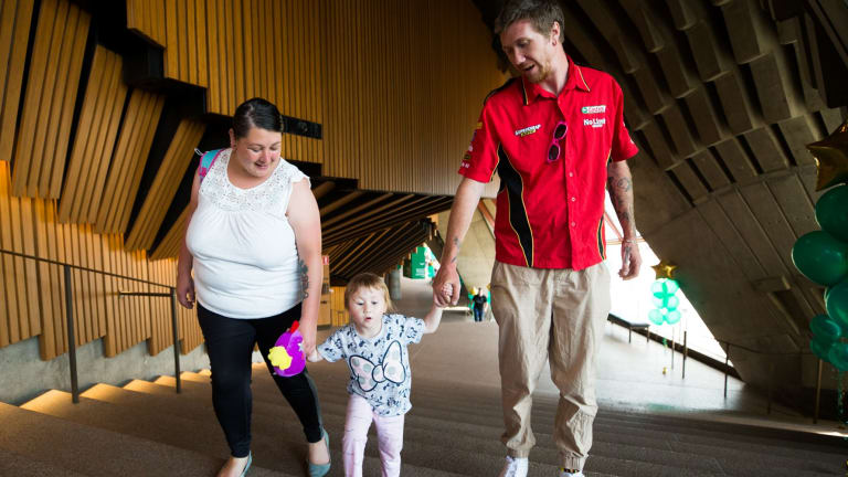Shaun Birmingham and Jasmine Solis, with their daughter Nevaeh in the Sydney Opera House.