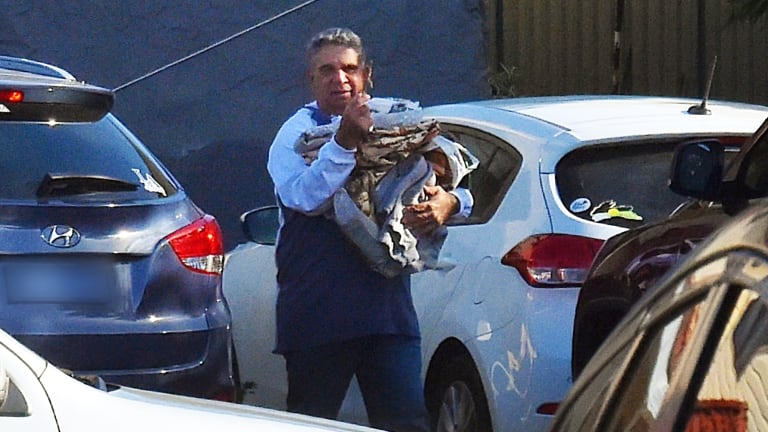 Former Wallaby player and chief executive of Guardian Youth Care Glen Ella leaves his home.