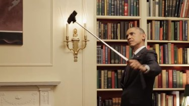 US President Barack Obama captures himself on a selfie stick in this still from the video.