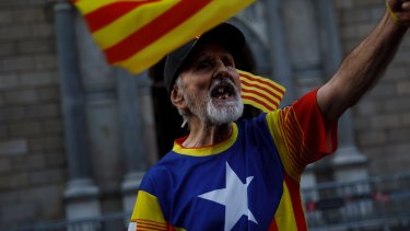 A Catalonia independence supporter wearing the Estelada flag stamped on his t-shirt in Barcelona in October.
