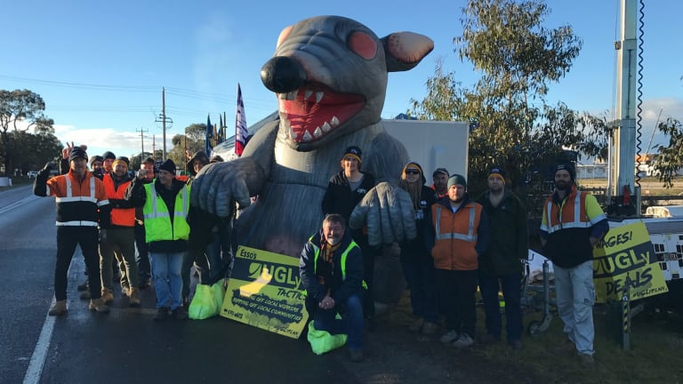 Employee anger: Unions agreed to deflate ''Scabby the Rat' at a picket line at Esso's Bass Strait operations.