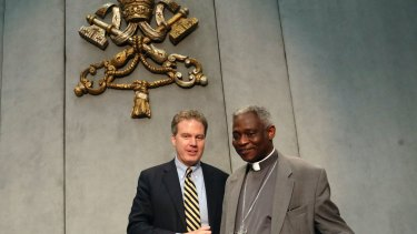 Vatican spokesman Greg Burke with Cardinal Peter Turkson, who is the only Vatican official scheduled to speak in the meeting of business leaders and NGOs.