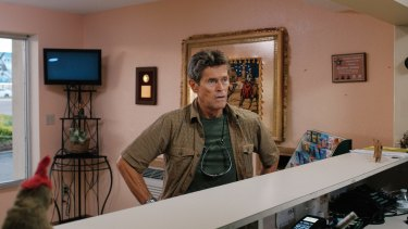 Willem Dafoe as motel manager Bobby.