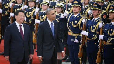 Deal done: Chinese President Xi Jinping and US President Barack Obama in Beijing.