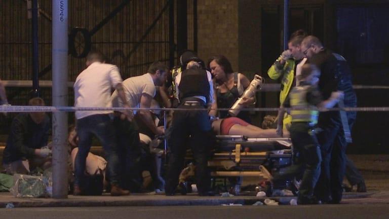 People receive medical attention in Thrale Street near London Bridge.