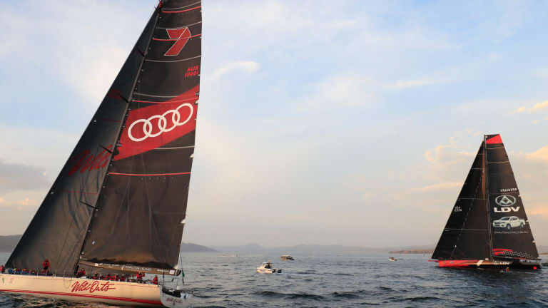 Duelling boats: Wild Oats XI (left) and LDV Comanche duel on the Derwent River on Wednesday.
