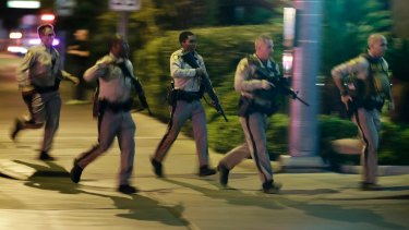 Police at the scene of a shooting near the Mandalay Bay resort and casino on the Las Vegas Strip.