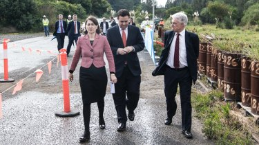 Premier Gladys Berejiklian (left), WestConnex Minister Stuart Ayres and Sydney Motorway Corporation chief executive Dennis Cliche early this month.