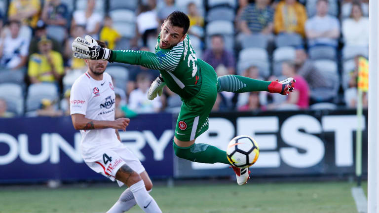 Beaten: Wanderers goalkeeper Vedran Janjetovic can't stop Petros Skapetis's header for the Mariners to draw the game back to 2-1.