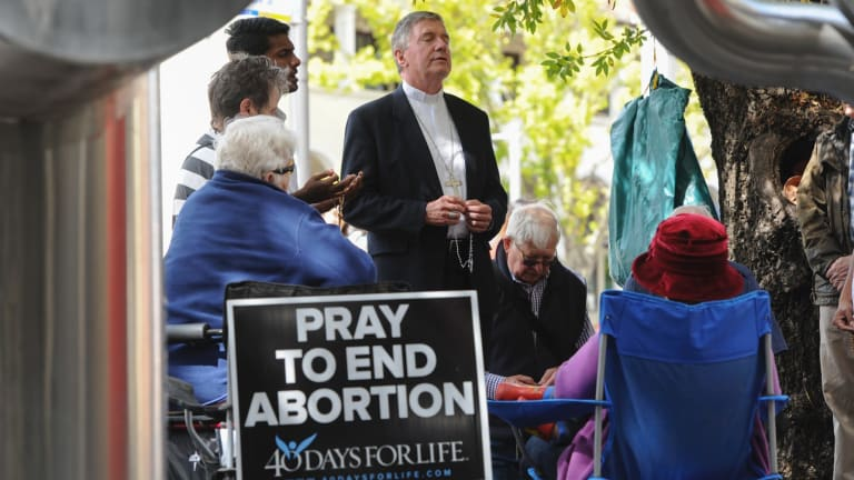 Canberra Goulburn Catholic Archbishop Christopher Prowse leads prayers during the 40 Days for Life campaign outside Civic's abortion clinic last year.