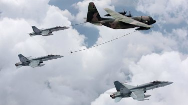 A Singapore C-130 Hercules tanker refuels F/A-18 Hornets from Australia's 3 Squadron during exercises in 2009.