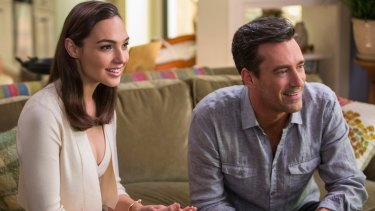 Gal Gadot with Jon Hamm in the comedy, <i>Keeping up with the Joneses</i>.