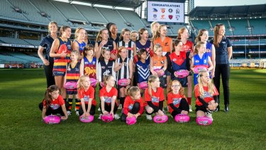 Daisy Pearce (far right) with fellow players and potential future stars at the launch of the AFL women's league on Wednesday.