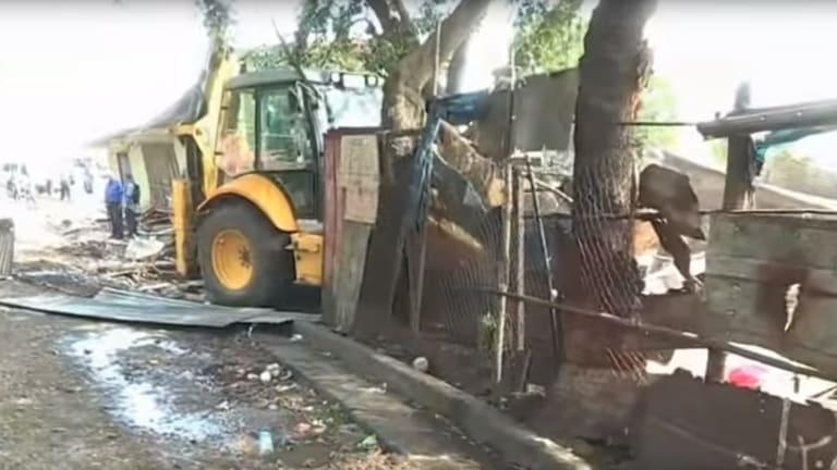 Bulldozers demolishing the shanty town at Paga Hill, Port Moresby.