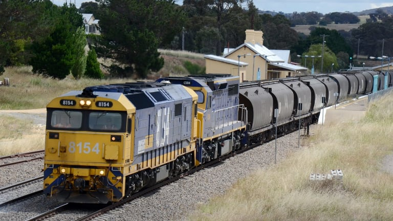 Port Kembla-bound Pacific National export wheat train passing through Gunning station.