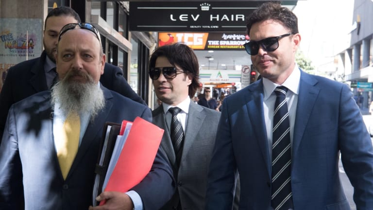 Fadi Ibrahim (second from right) was arrested in connection with an alleged drug and tobacco importation ring.