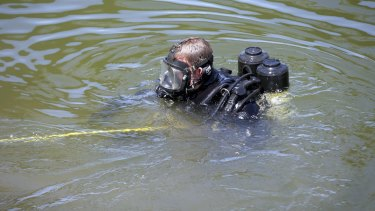 A police diver in the Maribynong River in February.