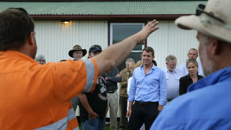 Premier Mike Baird hears from a miner opposed to the expansion of the Rio Tinto mine near Bulga.
