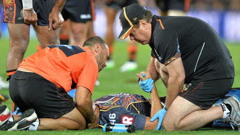 Tough start: Kyle Turner is attended to by medical staff after being tackled by Paul Gallen on Friday night.