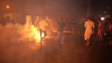 Iraqi riot police spray water and tear gas at the protesters.