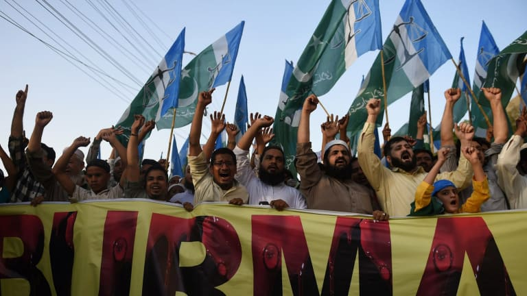 Pakistani activists protest in support of Rohingya Muslims in Karachi on Sunday.