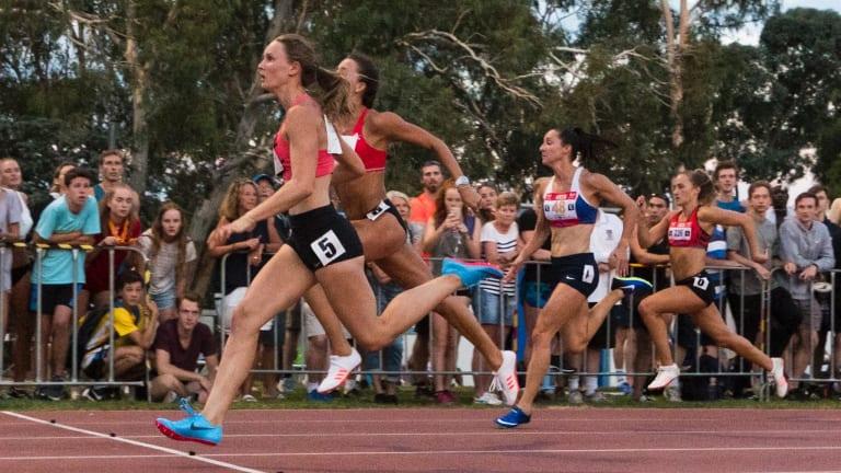 Riley Day wins women's 100 metre final.