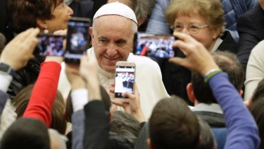 Pope Francis exchanges Christmas greetings with Vatican employees.
