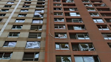 The outside of Mr Wang's apartment building in the Tianjin Economic and Development Area, showing damage to every home.