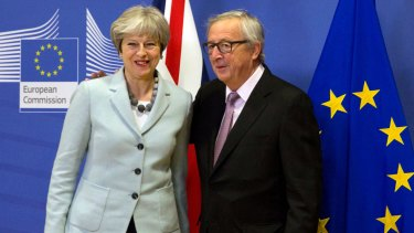 British PM Theresa May is greeted by European Commission President Jean-Claude Juncker ahead of a meeting at EU headquarters in Brussels.