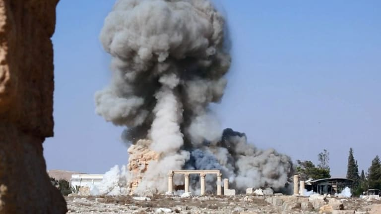 Smoke from the detonation of the 2000-year-old temple of Baalshamin in Syria's ancient caravan city of Palmyra, seen in this undated photo which was posted last year on a social media site used by Islamic State militants.