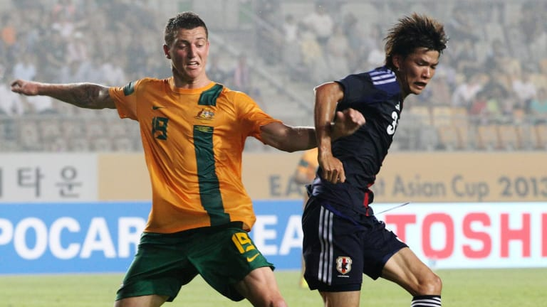 Mitchell Duke playing for the Socceroos against Japan.