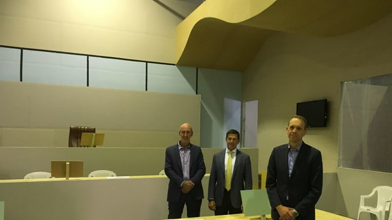 From left, architect Cameron Lyon, Juris Partnership general manager David Lovell, and Attorney-General Simon Corbell who toured the mock courtroom on Tuesday.