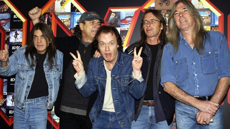 AC/DC's Malcolm Young (left) with Brian Johnson, Angus Young, Phil Rudd and Cliff Williams pose for photographers at the Apollo Hammersmith in London in 2003.