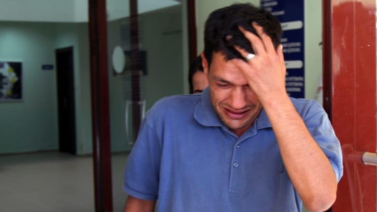 """""""My children slipped from my hands"""": Abdullah Kurdi tried to find his children as his wife held onto the capsized boat."""