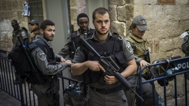 Rising tensions: Police and security stand guard in Jerusalem last week.