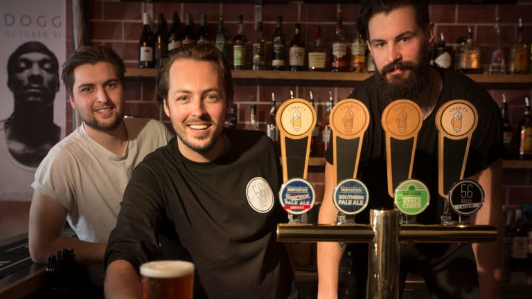 Charity Tap founders Robbie Gillies (white T-shirt) and Marcus Crook (long beard) with 56 Bricks bar co-owner Chace Harty.