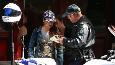A police officer talks to a pedestrian in the Sydney CBD.