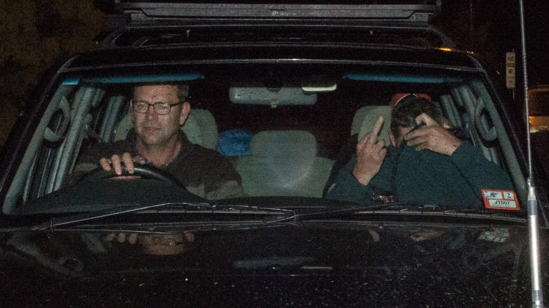 Mark Tromp leaves the Wangaratta Police Station (right) at night after being found.