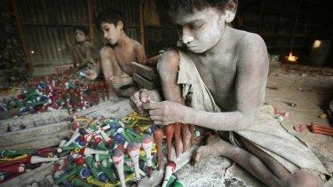 Bangladeshi child labourers work at a balloon workshop in Kamrangir Char, on the outskirts of Dhaka, Bangladesh.