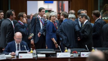 Theresa May, UK prime minister, centre, looks on ahead of roundtable talks with European Union (EU) leaders in Brussels.