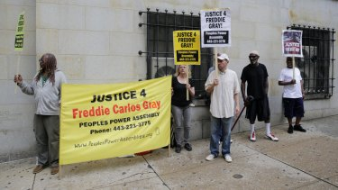 Demonstrators outside a courthouse await a verdict in the trial of officer Caesar Goodson.