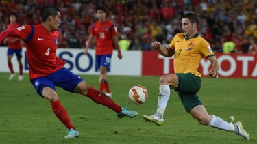 Impressive workrate: Socceroo Mathew Leckie takes on South Korean defender Jim Ju Young during the Asian Cup final.