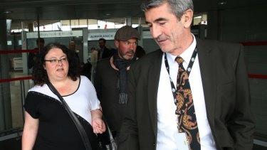 Lisa Parkinson is greeted by an Australian Embassy official at the airport in Paris.